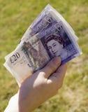 Handful of money Stock Image