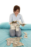 Handful of money bed Stock Image