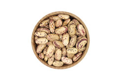 A handful of mung bean seeds in a wooden bowl Stock Image