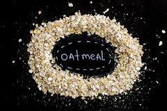 A handful of oatmeal - cereal healthy breakfast to start the day. Diet and healthy lifestyle. top view Stock Photography