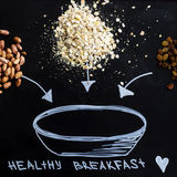 A handful of oatmeal - cereal healthy breakfast to start the day. Diet and healthy lifestyle. top view Stock Photo