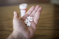Handful Of White Opioid Painkillers Stock Photography