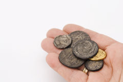 Handful of old roman coins. Hand with a collection of old roman coins