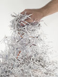 Handful of paper. Hand man of handful strips of paper royalty free stock photo
