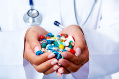 Handful of pills Stock Photos