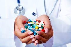 Handful of pills Stock Photos