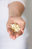 Handful of pills Stock Images