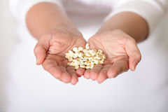 Handful of pills Stock Photography