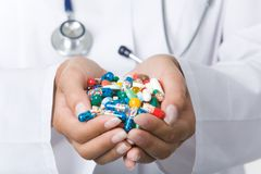 Handful of pills. Close-up of vitamins and pills in human hands Royalty Free Stock Image