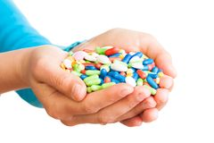 Handful of pills Royalty Free Stock Photos
