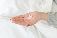 Handful of pills Stock Photo