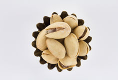 Handful of pistachios a figured shape. On a white background Royalty Free Stock Photo