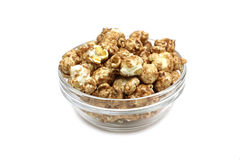 A handful of popcorn in a glass cup Royalty Free Stock Photos