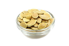 A handful of pumpkin seeds in a glass dish Stock Images