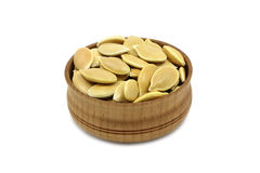 A handful of pumpkin seeds in a wooden bowl Royalty Free Stock Photography
