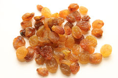 A handful of raisins. On a white background Royalty Free Stock Photos