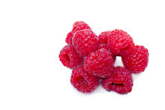 Handful of raspberries. Few raspberries on a white background closeup. View from above Stock Image
