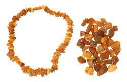 Handful of raw amber and necklace made of it Stock Images