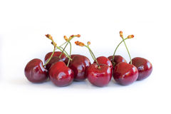 Handful of real cherries on white Stock Image