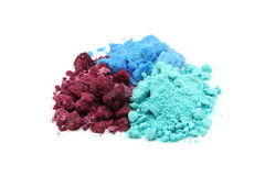 Handful of red, blue and green salt. On white background Royalty Free Stock Image