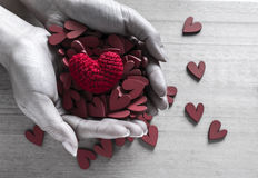 Handful of Red Heart Shaped Blocks and Red Heart Shaped Silk Royalty Free Stock Photography