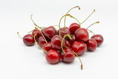 A handful of red ripe an juicy cherries stock photography