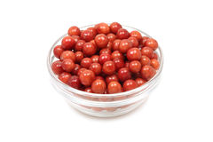 A handful of red viburnum berries in a glass bowl Royalty Free Stock Photography