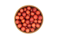A handful of red viburnum berries in a wooden bowl Stock Images