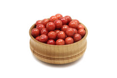 A handful of red viburnum berries in a wooden bowl Stock Image