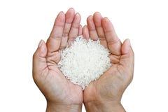Handful of rice Stock Photo