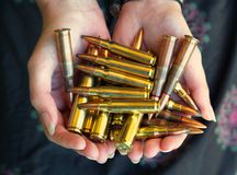Handful of Rifle ammunition  Stock Photo