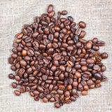Handful of roasted coffee beans Stock Image