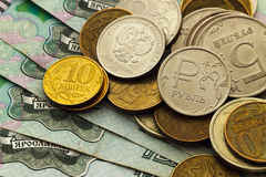 A handful of Russian coins of different denominations. Against the background of one thousand bills Royalty Free Stock Image