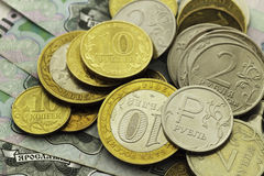 A handful of Russian coins of different denominations. Against the background of one thousand bills Royalty Free Stock Photo