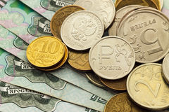 A handful of Russian coins of different denominations. Against the background of one thousand bills Royalty Free Stock Photography