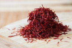 Handful of saffron. Handful of real saffron on a bamboo board, macro Stock Photos