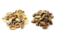 A handful of salted pistachios and pistachio shells Royalty Free Stock Photography