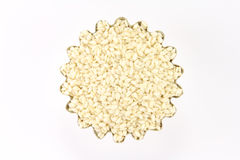 Handful sesame seeds in figured form. On a white background Stock Photo