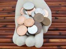 Handful of small change Stock Image