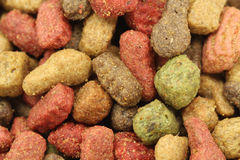 A handful of small granules pet food Royalty Free Stock Photos