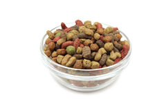 A handful of small granules pet food in a glass Stock Images
