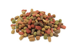 A handful of small granules pet food Stock Images