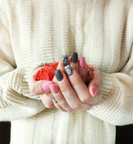 A handful of small hearts in the girl`s hands Royalty Free Stock Photo