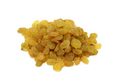 A handful of small yellow raisins Stock Photos