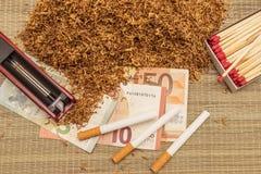 Handful of smoking tobacco Stock Photography