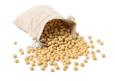 Handful of soy beans. Isolated on white background stock image