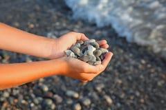 Handful of stones in hands Stock Photography