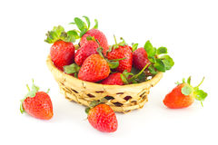 Handful of strawberries in a wicker basket. On a white background Stock Photo
