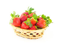 Handful of strawberries in a wicker basket. On a white background Stock Image