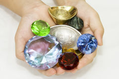 Handful of treasure. Gift of jewels, gems and treasures stock photo